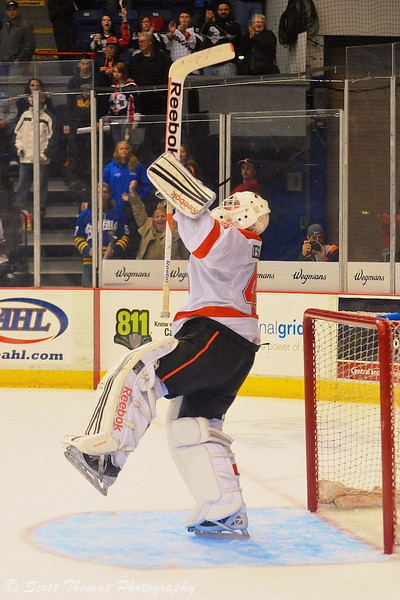 Syracuse Crunch goalie Jeff Deslauriers (43) celebrates his team's victory over the Adirondack Phantoms.