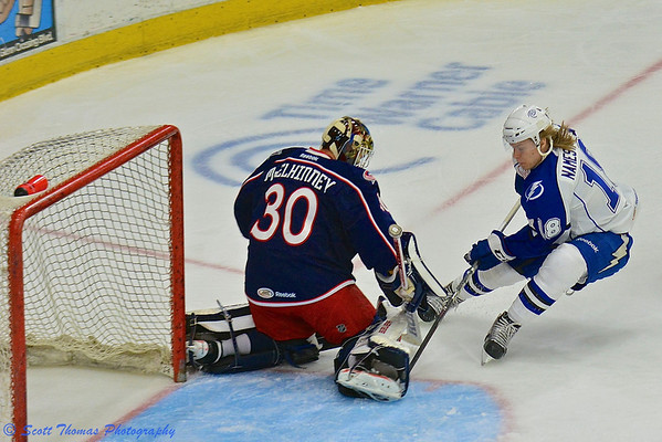 Syracuse Crunch Vladislav Namestnikov (18) tries to stuff the puck past Springfield Falcons goalie Curtis McElhinney (30) in American Hockey League (AHL) Calder Cup Playoff action at the Onondaga County War Memorial on Friday, May 17, 2013.