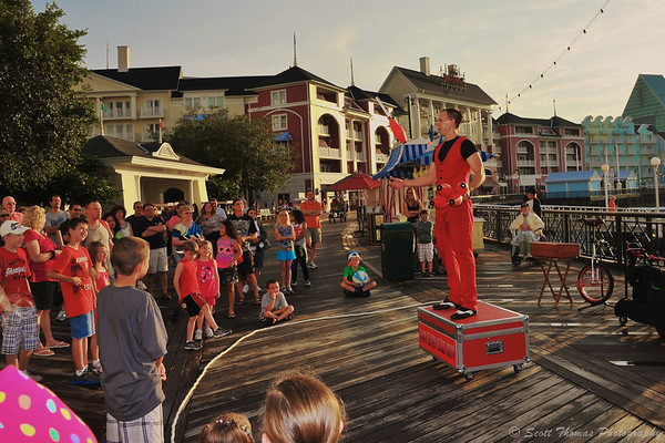 The Cool Hand Luke Juggling Show entertaining guests on The Boardwalk in Walt Disney World, Orlando, Florida.