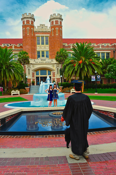 New Graduates pose for photos in front of the Westcott Building on the Florida State University campus in Tallahassee.