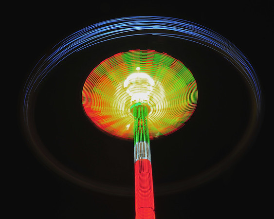 A long exposure photograph of the SKY Flyer ride on the New York State Fair Midway.