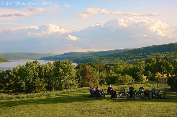Guests at the Bristol Harbour Resort in Canandaigua, New York sit around the fire pit in late afternoon.