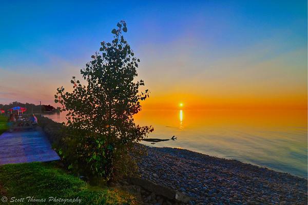 Sunset at Rudy's Lakeside restaurant on the shore of Lake Ontario near Oswego, New York.