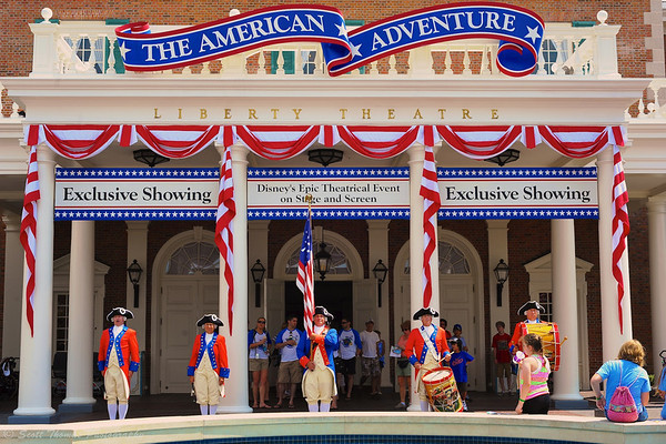Spirit of America Fife & Drum Corps performing in front of the American Adventure at Epcot's World Showcase in Walt Disney World.