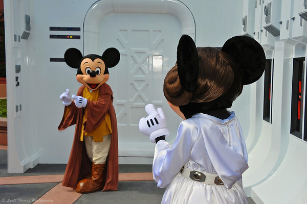 Princess Minnie waving to Jedi Mickey during Star Wars Weekend at Disney's Hollywood Studios.