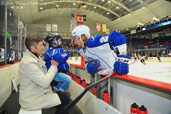 Syracuse Crunch Eric Neilson meets a young Bench Buddy at the OnCenter War Memorial in Syracuse, New York.