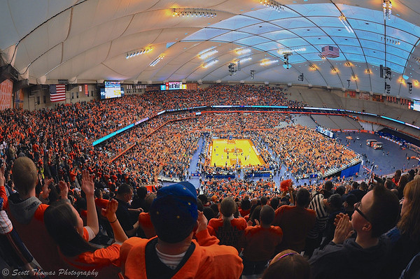 Fans stand and cheer as time runs down at the end of the Syracuse University Orange Men's basketball team defeated the Villanova Wildcats, 78-62, at the Carrier Dome in Syracuse, New York on Saturday, December 28, 2013.