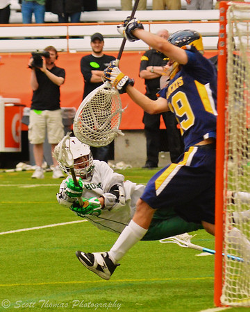 Fayetteville-Manlius Hornets Casey Green (1) scores the game-winning goal past West Genesee's Matt Koziol (19) with 2 seconds remaining in the Class A Boys Lacrosse Section III Finals at the Carrier Dome in Syracuse, New York on Saturday, May 24, 2014.