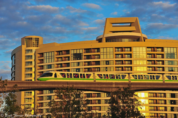 Close up of Monorail Green passing in front of Bay Lake Tower DVC Resort in Walt Disney World.