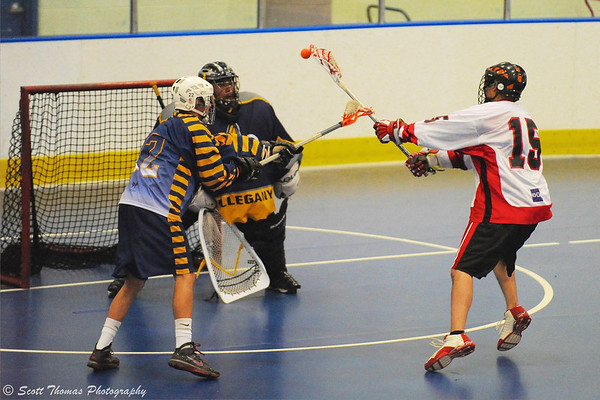 "Onondaga Red Hawks Grant Bucktooth (15) sidesteps an Allegany Arrows defender before scoring a goal in Can-Am Senior ""B"" Box Lacrosse league action."