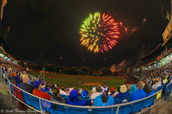 Fireworks explode over the NBT Bank Stadium in Syracuse, New York after the Syracuse Chiefs baseball game on July 4, 2014.