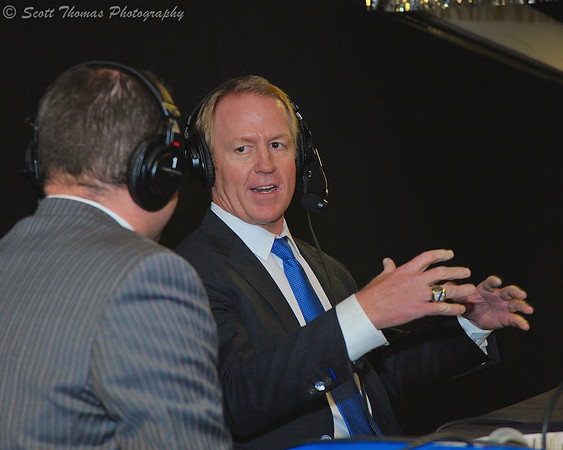 Brian Leetch talks with Syracuse Crunch announcer Dan D'Uva (with back to camera) during a post game radio show in the War Memorial Arena, Syracuse, New York on Saturday, February 8, 2014.
