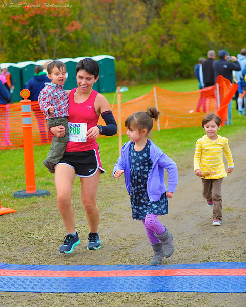 This mother brought her whole crew with her as she hit the finish line at the Apple Run 15K Road Race in LaFayette, New York.