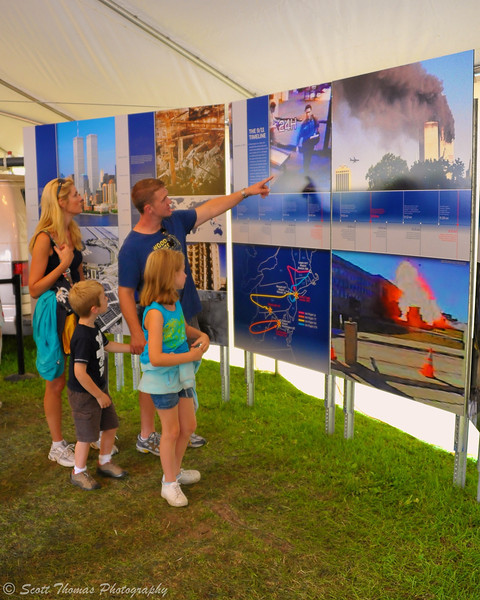 A family remembering and learning about the 9/11 attack on the World Trade Center on September 11, 2001 in the New York Remembers exhibit at The Great New York State Fair in Syracuse, New York.