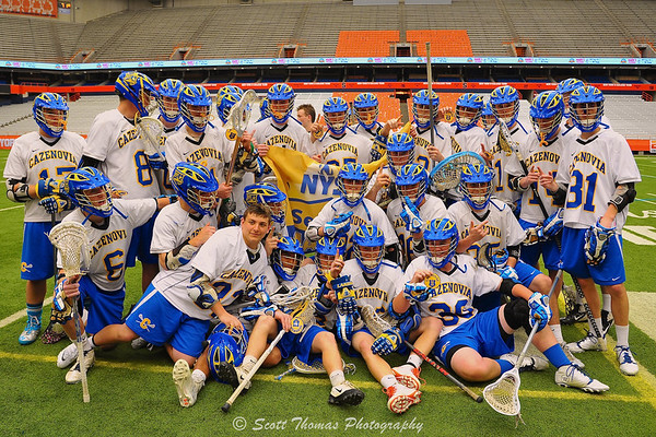 Cazenovia Lakers pose for a team championship photo after defeating the Homer Trojans in the Class C Boys Lacrosse Section III Finals at the Carrier Dome in Syracuse, New York on Saturday, May 24, 2014. Cazenovia won 12-8.