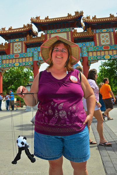 Vacationer posing at the China pavilion in Epcot, Walt Disney World, Orlando, Florida.