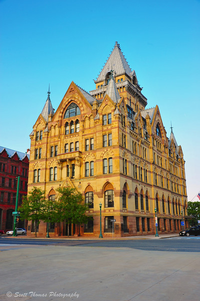 The Syracuse Savings Bank building in Clinton Square during the golden hour.