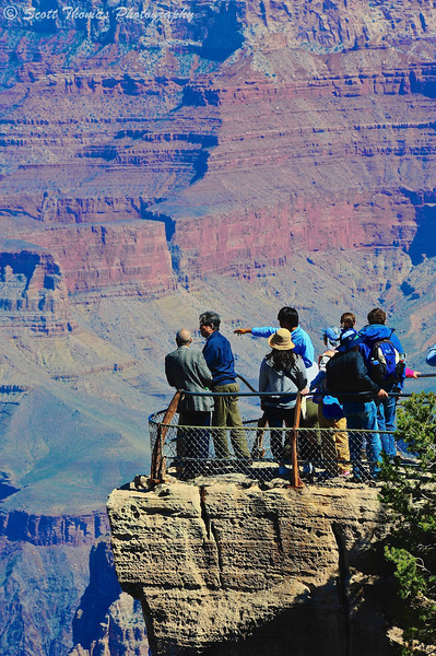 People viewing the Grand Canyon from Mather Point at Grand Canyon National Park in Arizona.