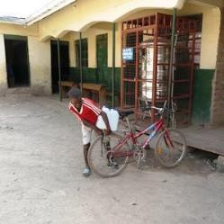 boy fetching drinking water for famuly