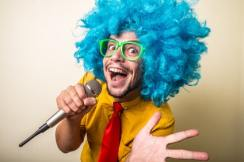 crazy funny young man with blue wig