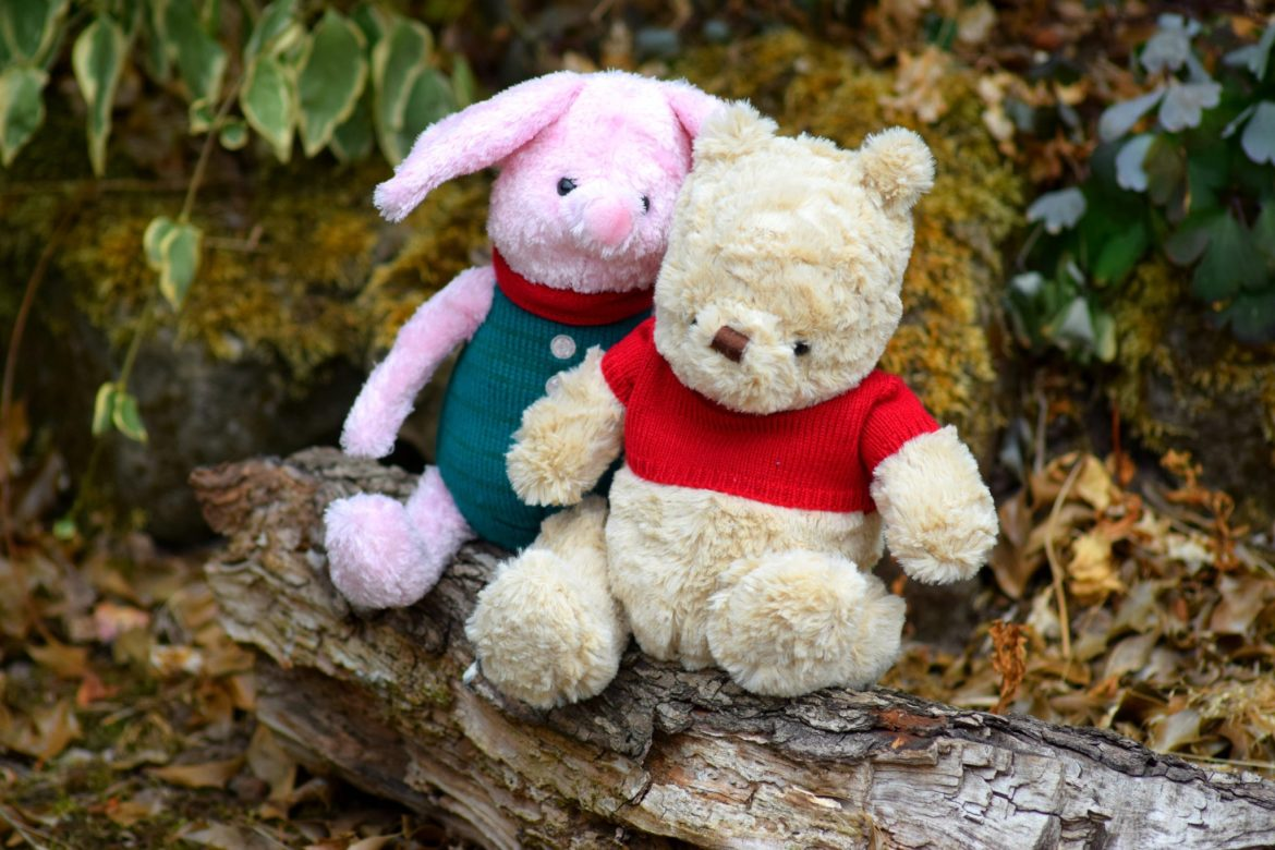 Winnie the Pooh and piglet sitting on a branch. Christopher robin movie.