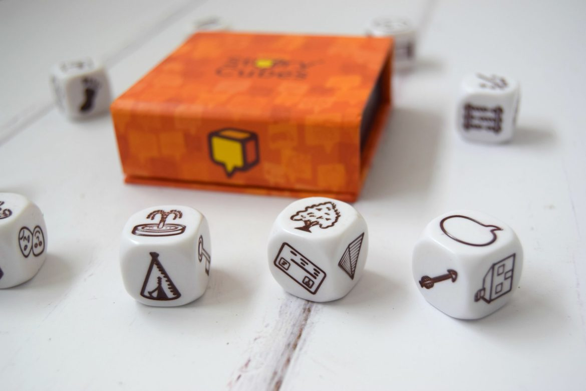 Rory's Story Cubes game review. The 9 dice each have images on to use to make up a story.