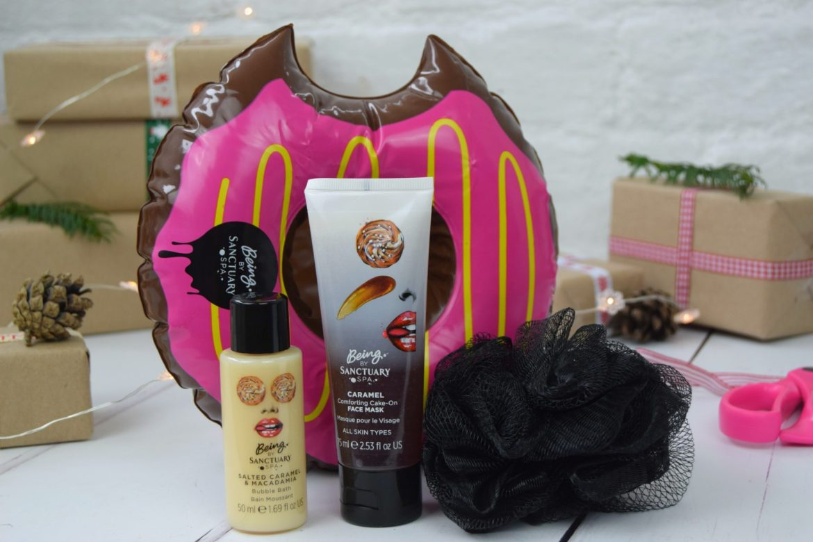 Sanctuary Spa donut gift set with face mask, cream and a floating donut cup holder for the bath.