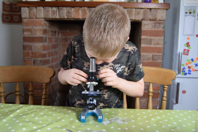 Jayden looking into his microscope