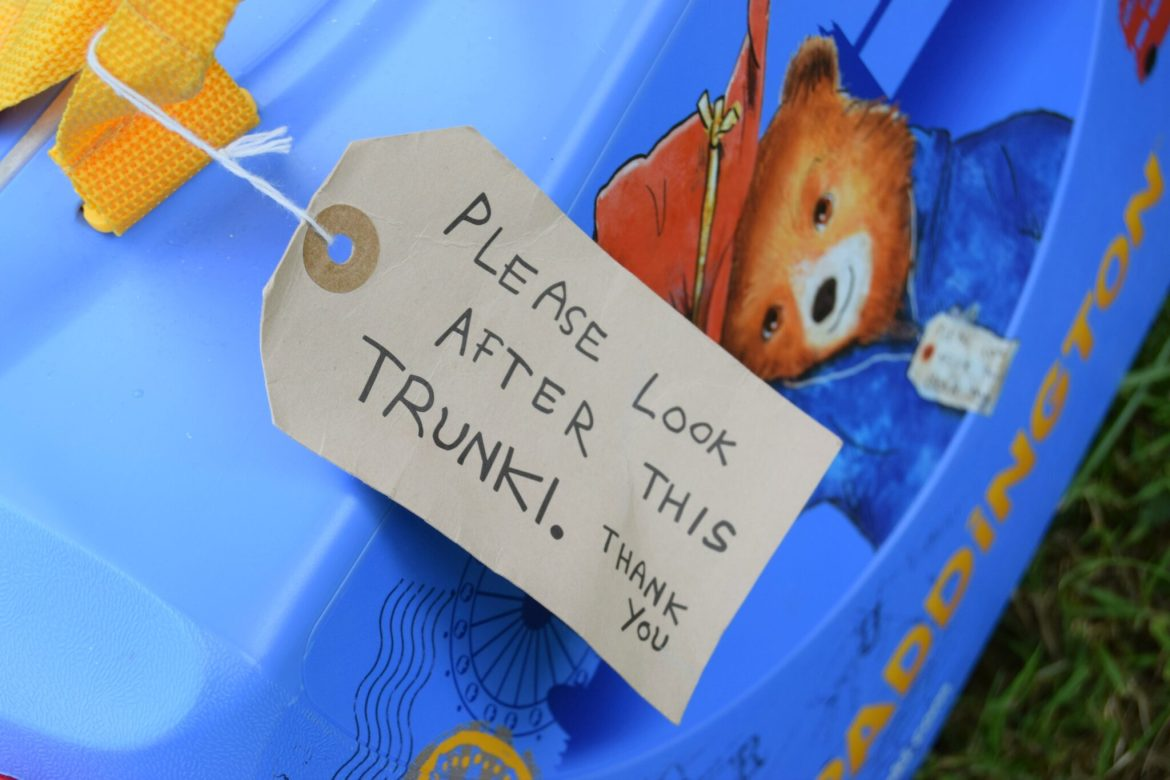 Paddington Bear Trunki Suitcase with tag reading - Please look after this trunk! Thank you.