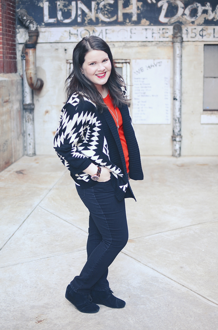 Fall & Winter Style: black and white aztec sweater, black jeans, black TOMS wedges, tassel necklace