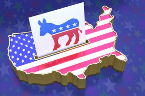 3D Illustration Ballot box in shape of USA map with flag superimposed. Ballot paper containing Democratic party logo in slot. All on blue background with stars.