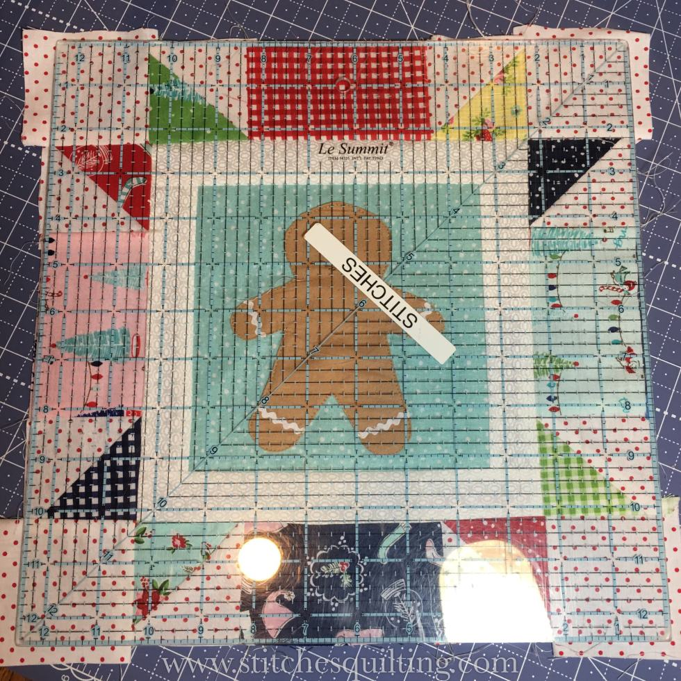 Squaring up the final 12.5 Cozy Christmas Gingerbread Block. It's important to press and then square up after each step.