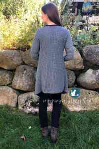 Free crochet pattern for an adorable blanket cardigan. This cardi is fashionable and functional. Made in Lion Brand Jeans Yarn it is soft, warm and comfortable. The cascading effect makes a beautiful flowing sweater.