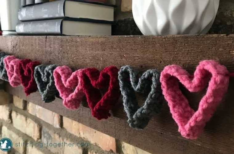 Get ready for Valentines Day with this adorable crochet heart garland. Perfect quick and easy way to DIY your Valentines Day decor. The garland would also make a cute decoration for a little girls room.   Free crochet pattern #ValentinesDaydecro #heartsgarland #crochethearts #freecrochetpattern