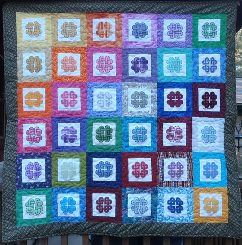 Knotted Hearts Quilt stitched by World of Charity Cross Stitch Group