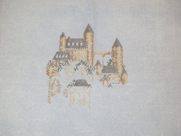 work in progress cross stitch project of Castle Ridge on opalescent lugana fabric
