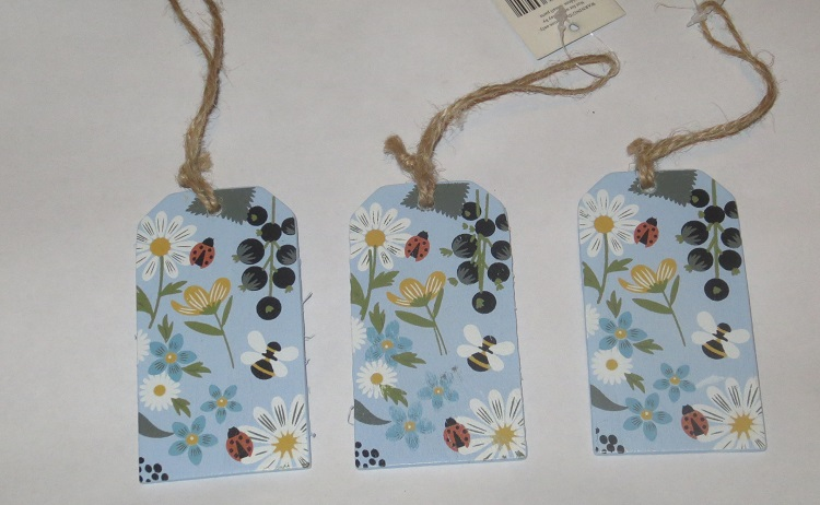 painted gift tags inside the Cotton & Twine stitching subscription box