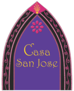 Casa San Jose logo, a stained glass window that is all purple with a pink flower at the top and the organization name in Gold in the middle of it