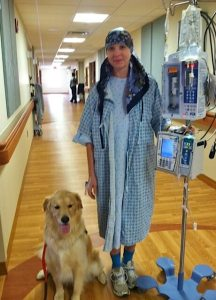 A hospital patience with a therapy dog