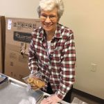 Sister Fran packs Christmas cookies for inmates of the Beaver County Jail.