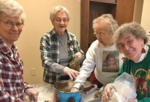 Sisters pack Christmas cookies into bags for inmates of the Beaver County Jail.