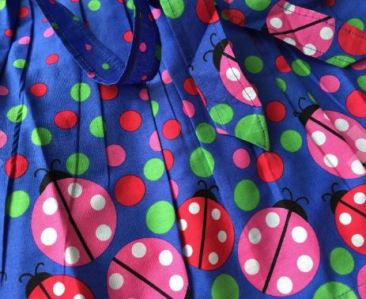 I love this bright fabric on the middle dress!