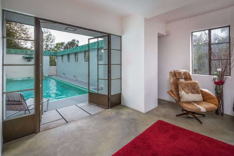 a-sitting-room-is-located-just-off-the-pool