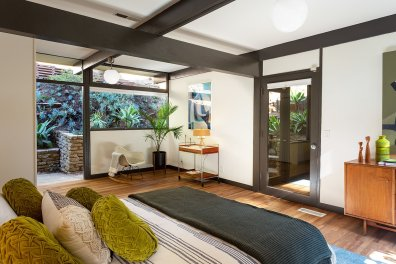 red-brick-is-traded-for-hardwood-floors-in-all-of-the-homes-bedrooms-here-the-master-bedroom-provides-direct-access-to-the-backyard