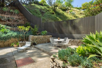 the-patio-continues-to-the-front-of-the-home-where-an-enclosed-courtyard-provides-additional-outdoor-space-for-entertaining-or-relaxing