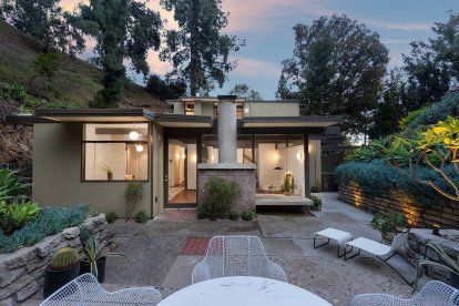 the-side-of-the-home-opens-onto-a-lush-patio-complete-with-terraced-planters-and-new-landscape-lighting-views-from-the-opposite-direction-look-up-to-the-hollywood-sign