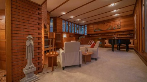 another-view-of-the-living-area-shows-the-built-in-shelves-and-bench-along-the-rear-wall-one-of-the-homes-owners-john-peterson-reportedly-built-some-of-the-furnishings-by-following-wrights-plans