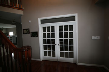 carter custom painting installs doors
