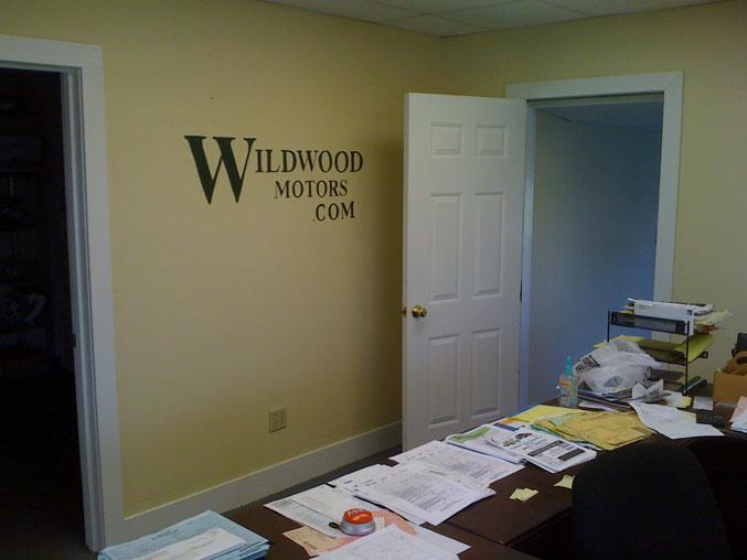 company logo handpainted on office wall