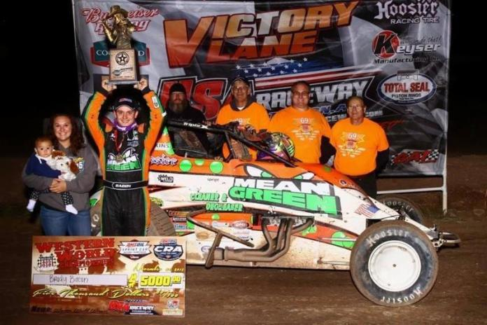 Brady Bacon of Broken Arrow, Oklahoma celebrates with his wife, his daughter, and the Hoffman/Dynamics, Inc. crew after winning Friday night's USAC AMSOIL National Sprint Car feature at USA Raceway in Tucson, Arizona. (Rich Forman Photo)